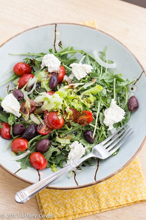Arugula and Celery Salad with Tomatoes, Onions, Olives and Herbed Cheese