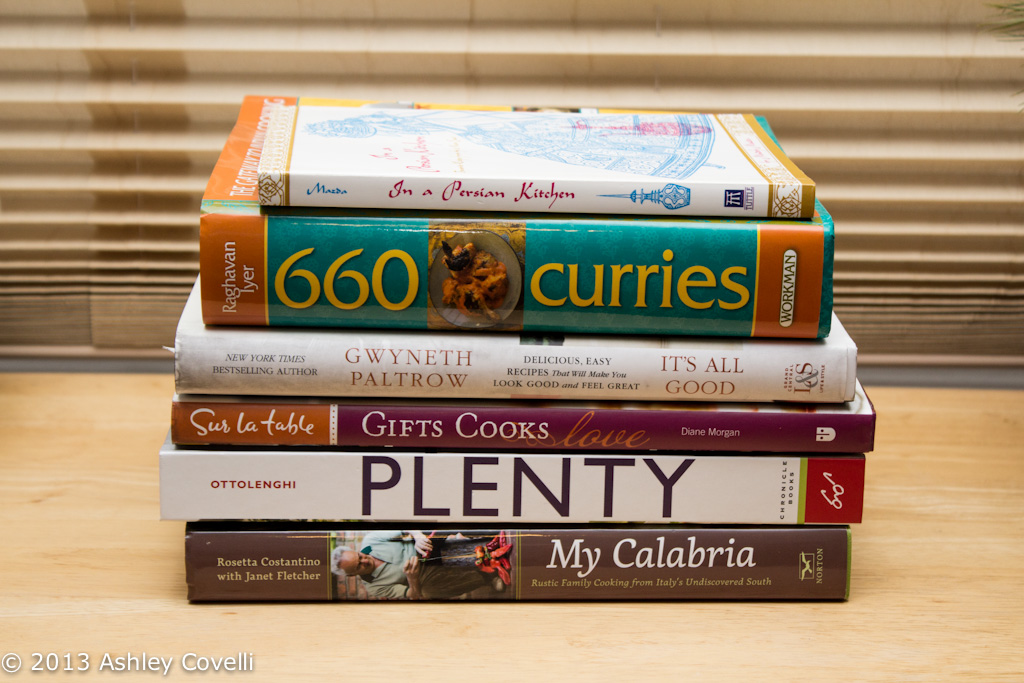 Side view of a stack of cookbooks