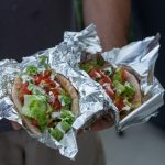 Pita sandwiches stuffed with NYC street cart-style chicken