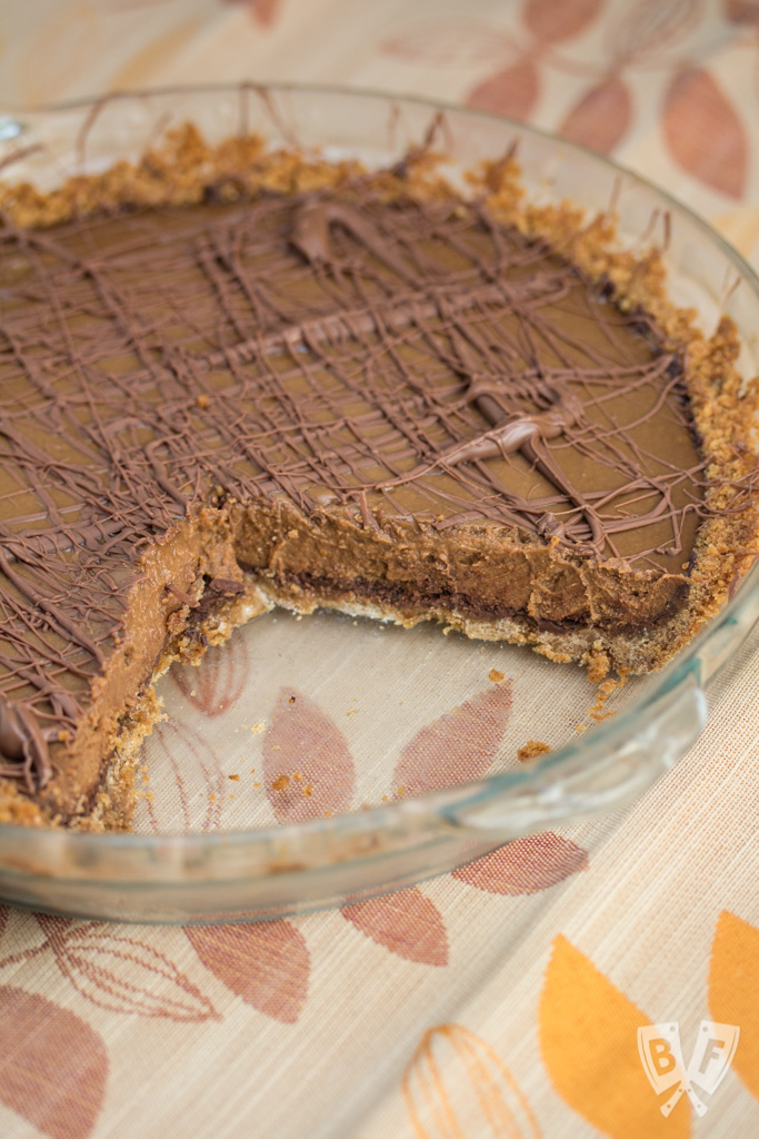 Triple-Chocolate Pumpkin Pie - Graham cracker crust is slathered with a layer of bittersweet chocolate that's hidden beneath a pumpkin & semi-sweet chocolate filling. Sure to be your new Thanksgiving holiday favorite!