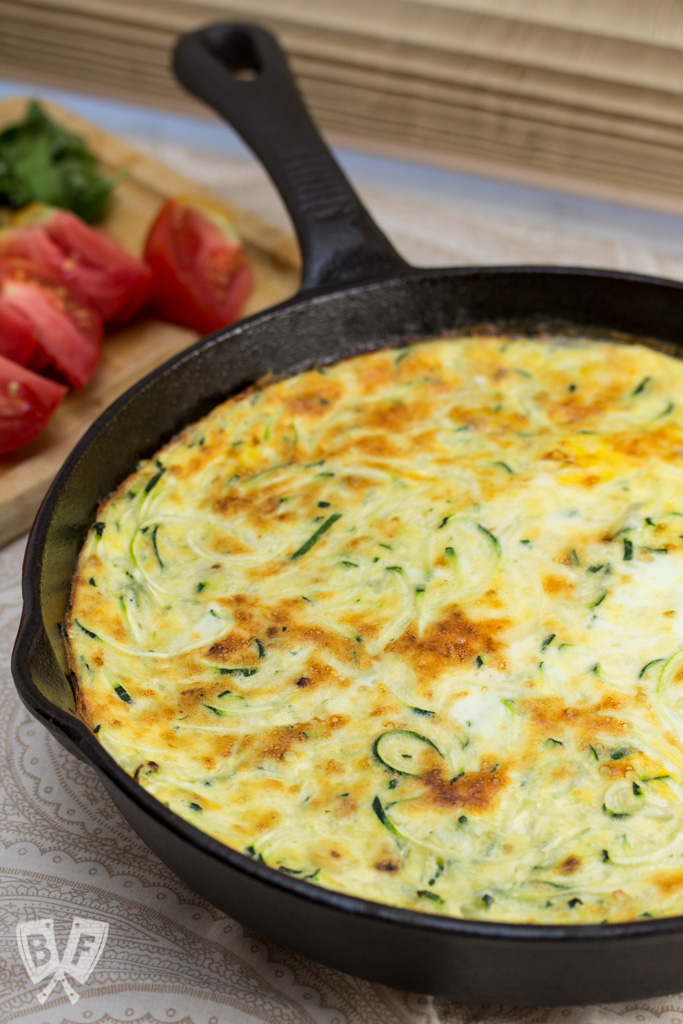 Zoodle Frittata - A drizzle of aged balsamic, grated Parmesan, garden fresh tomatoes and basil adorn this deliciously elegant yet simple breakfast dish.