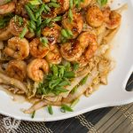Overhead view of Spicy Shrimp + Napa Cabbage Stir-Fry served on a platter.