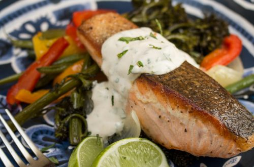 Crispy Skinned Salmon Over Roasted Veggies with Cilantro Mint Yogurt Sauce