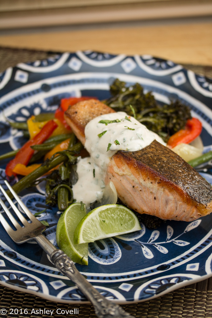 Crispy Skinned Salmon Over Roasted Veggies with Cilantro Mint Yogurt Sauce