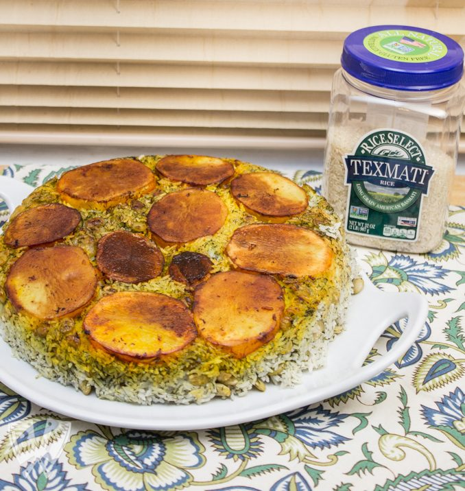 Polo Shevid Baghali (Persian Dill + Lima Bean Rice): Potatoes are fried in a buttery saffron mixture that help form a beautifully golden crust when this fragrant rice dish is turned out onto a platter. #ad