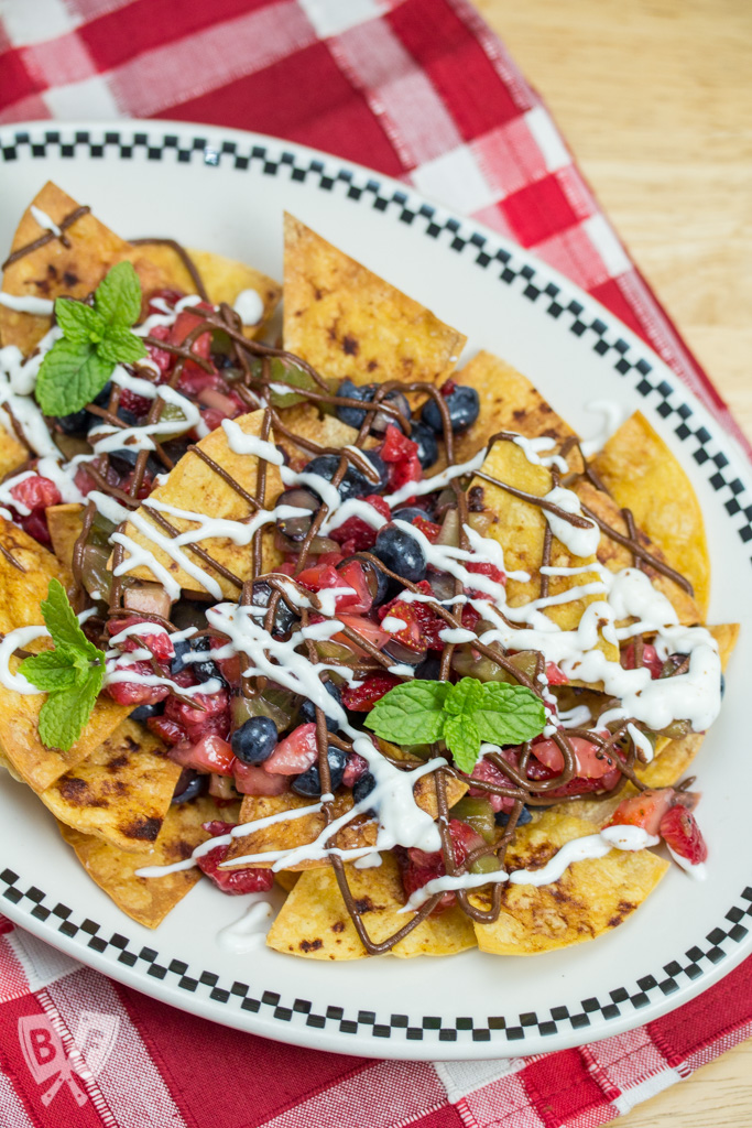 Dessert Nachos with Fresh Baked Cinnamon Tortilla Chips: A colorful fresh fruit salsa, honeyed Greek yogurt + chocolate hazelnut butter are piled atop this plate of sweet-and-salty nachos! #StonyfieldBlogger