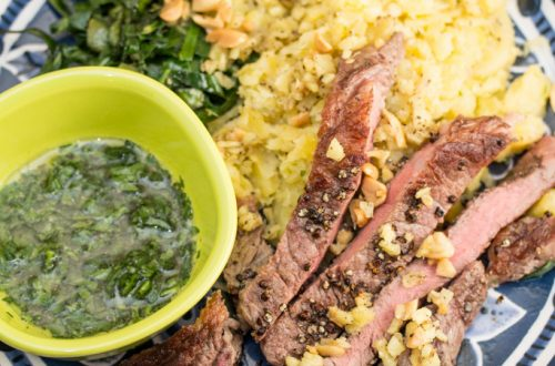 Grains of Paradise-Crusted Steaks with Mashed Plantain, Collard Greens & Ginger Peanuts: Switch up your meat and potatoes game with this West African-inspired meal.