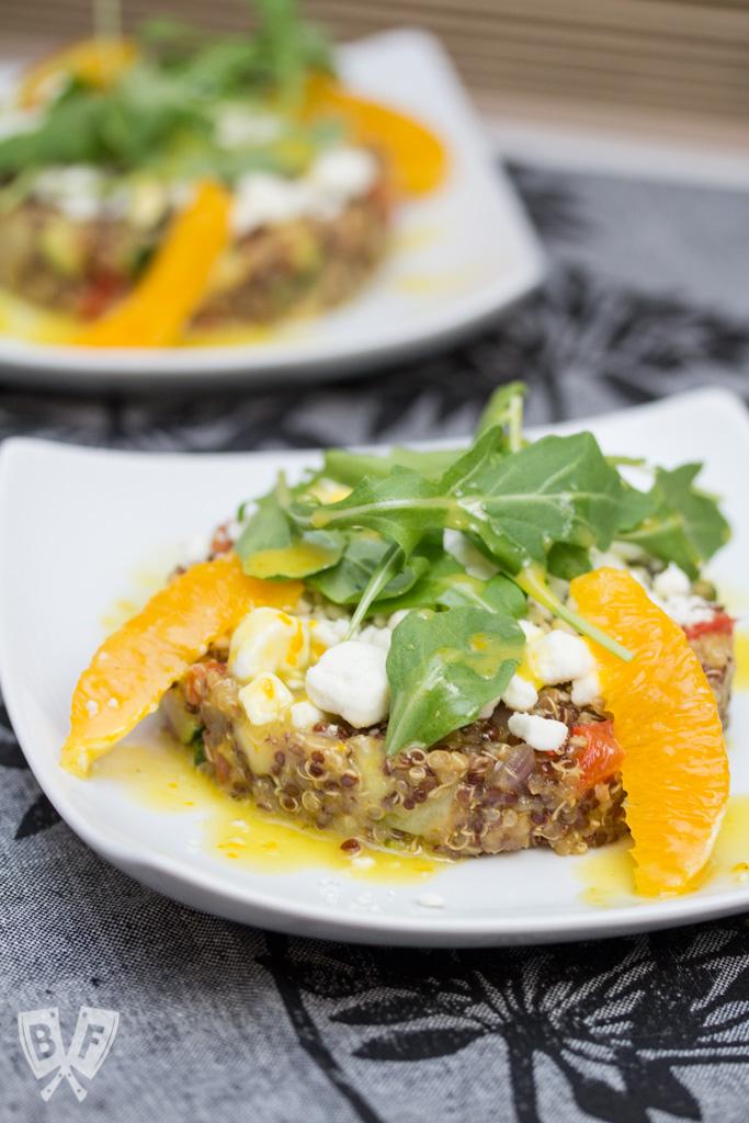 Pax Romana's Quinoa Salad with Mixed Vegetable, Goat Cheese & Orange Dressing: No more boring quinoa salad recipes! Fresh orange zest and juice go into the bold, bright vinaigrette for this beautifully plated restaurant recipe. #BigFlavorsFromARestaurantKitchen