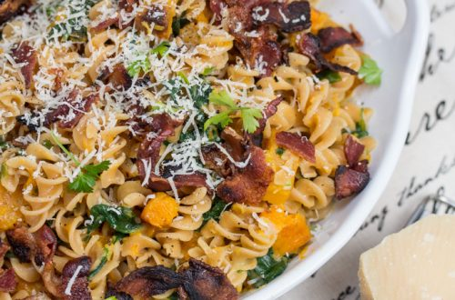 Red Lentil Fusilli with Bacon, Butternut Squash, & Spinach: Vibrant pasta made from red lentils brings a boost of protein and fiber to this scrumptious, salty-sweet bowl of comfort food.