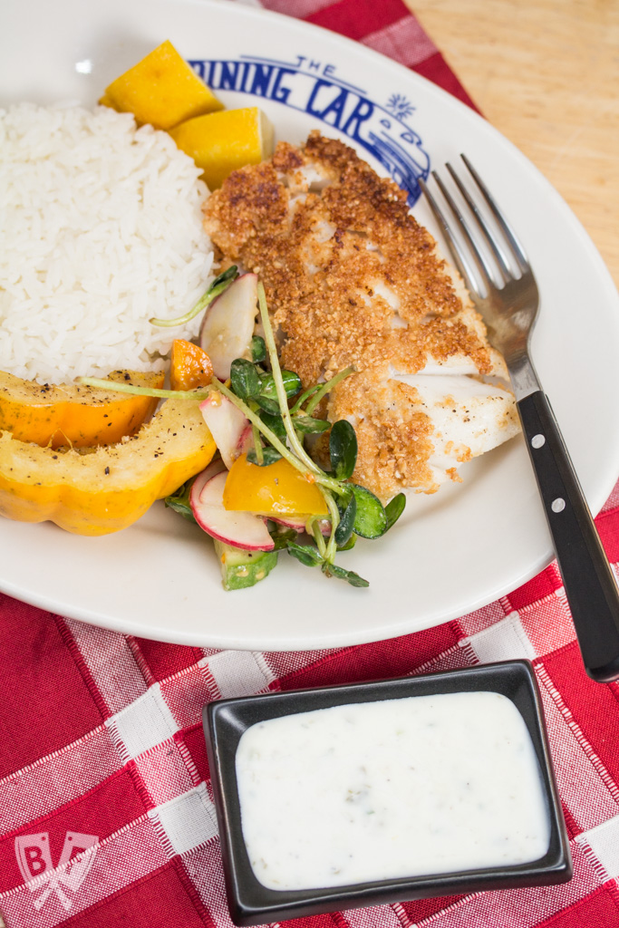 Lemony Almond Crusted Cod with Homemade Mayo-Free Tartar Sauce: Cod is coated with ground almonds and pan fried till beautifully flaky & tender in this delicious seafood recipe. Serve with my easy homemade tartar sauce! #StonyfieldBlogger #ad