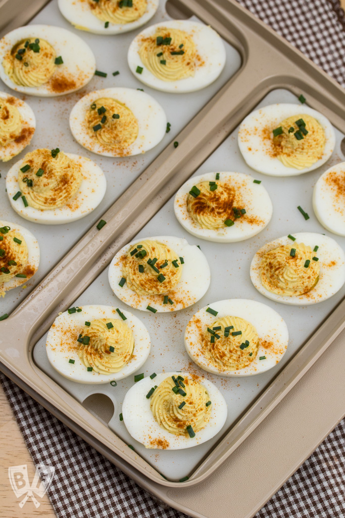 Overhead view of a platter of deviled eggs.