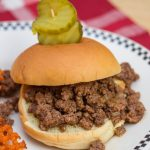 Sloppy Joe sandwich with pickles and sweet potato fries
