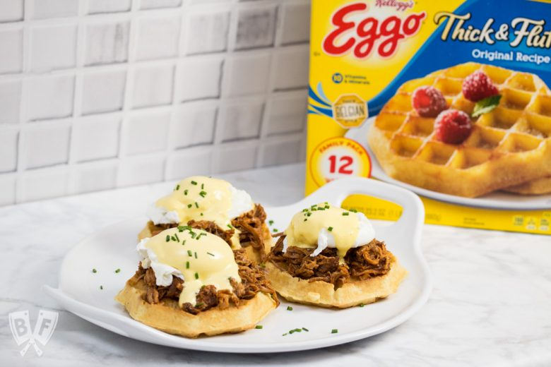 Thick, fluffy waffles are the perfect base for this sweet-and-salty BBQ pulled pork eggs Benedict topped with blender hollandaise sauce. #LeggoMyEggo #HearTheNews #CollectiveBias #shop #ad