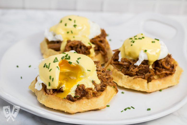 Thick, fluffy waffles are the perfect base for this sweet-and-salty BBQ pulled pork eggs Benedict topped with blender hollandaise sauce. #LeggoMyEggo #HearTheNews #CollectiveBias #ad