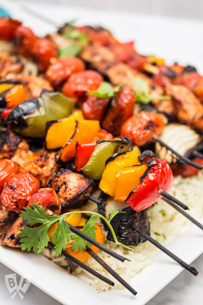 Chicken Fajita Skewers over Cilantro Cauliflower Rice: A rich, flavorful marinade makes these fajitas on a stick the perfect excuse to fire up the grill! Add a paleo side for a low carb summer meal! #OrganicMoments #ad