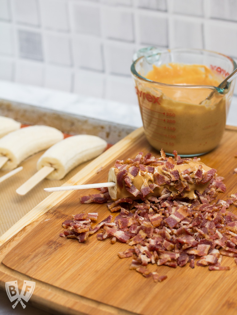 Elvis-Style Frozen Bananas take the classic Elvis sandwich (peanut butter, banana + bacon) to a new level! This easy 3 ingredient frozen dessert is fit for The King! #BaconMonth
