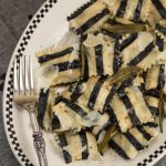 Ghost with the Most Roasted Sweet Potato Ravioli: Homemade black + white pasta is stuffed with roasted veggies, topped with brown butter sauce & crispy sage leaves in my Halloween tribute to Beetlejuice!