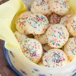 These ricotta cookies are a simple dessert recipe makes oodles of pillowy soft, tender cookies that are sure to be a family favorite! Perfect for cookie exchanges & holiday parties. They've been a family tradition for years!