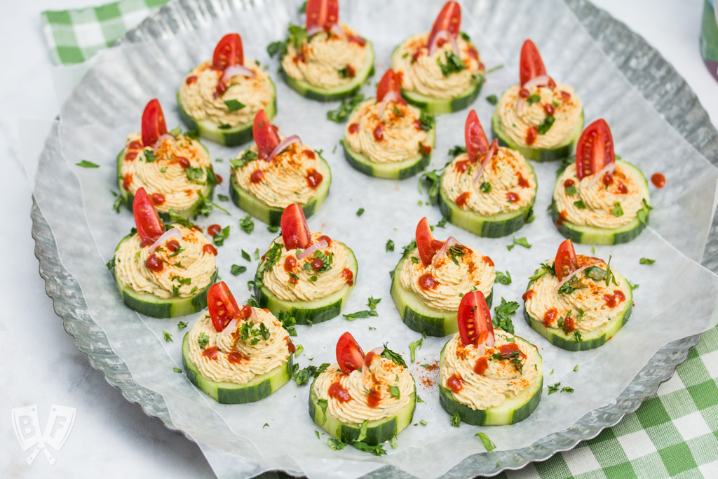 Platter of cucumber slices topped with a spiced chickpea purée.