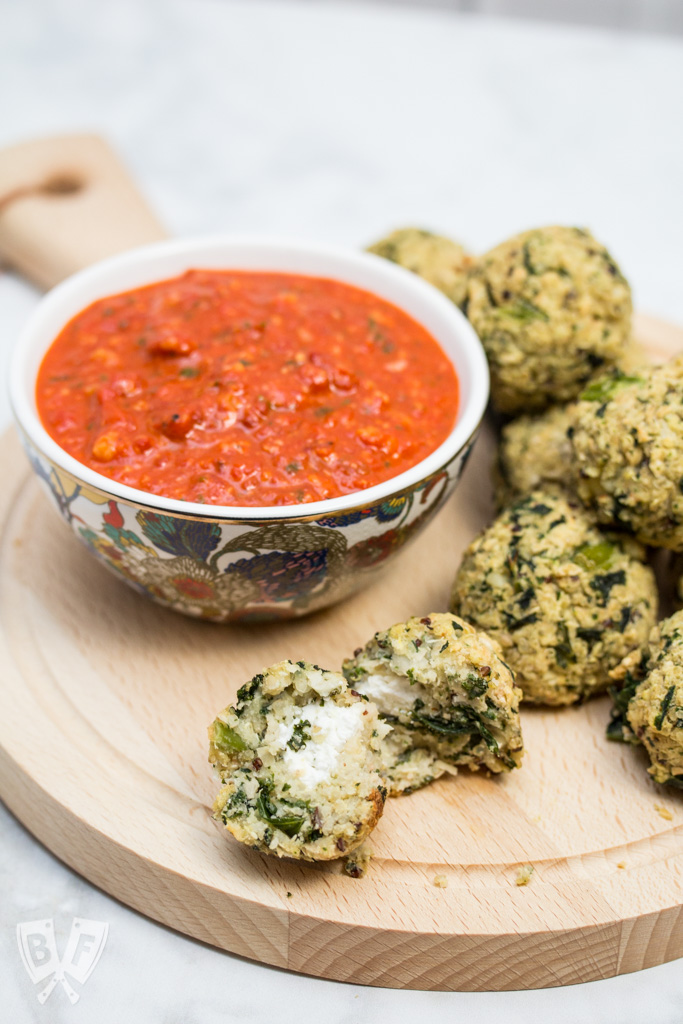"Goat Cheese-Stuffed Quinoa & Kale Balls with Romesco Sauce: (#ad) This hearty goat cheese-stuffed vegetarian ""meatball"" recipe with quick romesco sauce makes an elegant party appetizer or main course for Meatless Monday!"