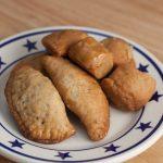 A plate of Turdilli & Chinudille Italian Christmas cookies