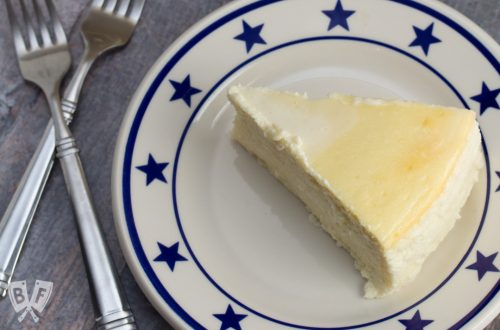 Overhead shot of a plate topped with a slice of Italian Cheesecake