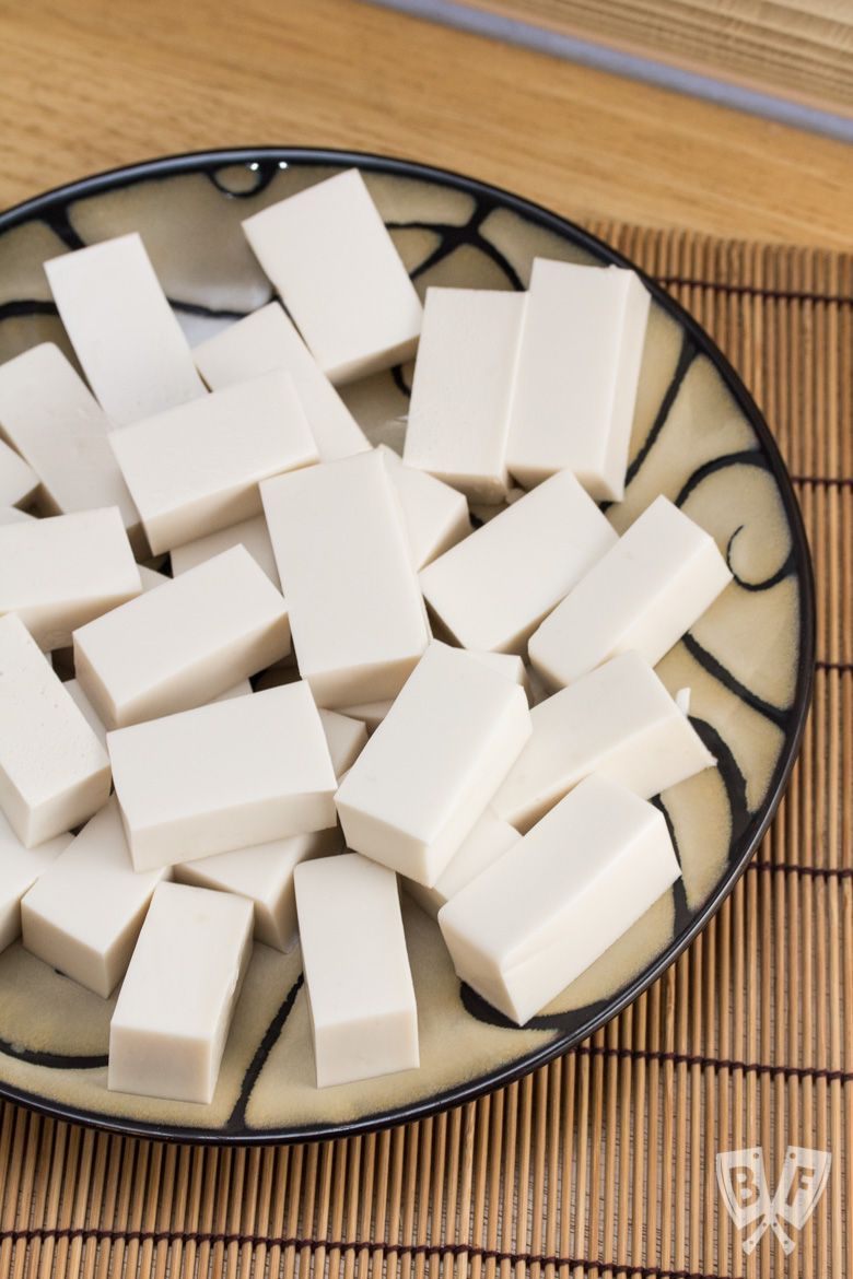 Overhead shot of a plate with rectangles of white coconut jelly.