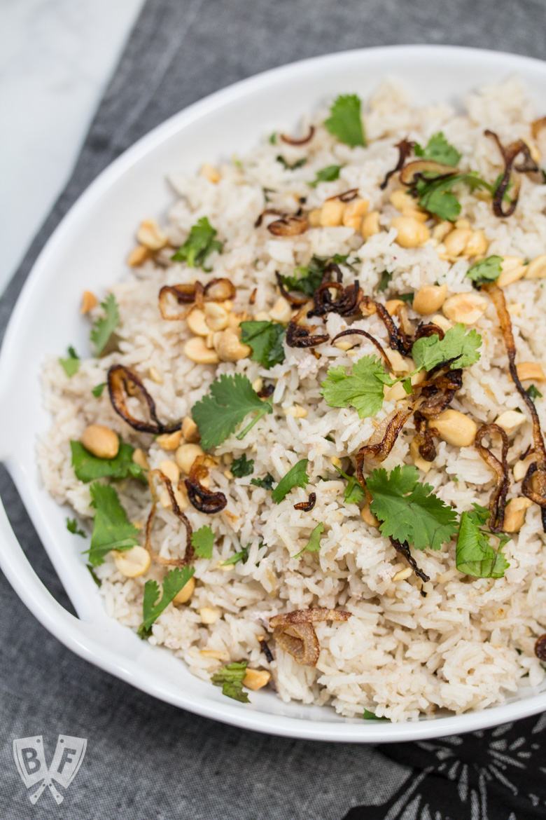 Overhead shot of a bowl of Peanutty Rice with Crispy Fried Shallots.