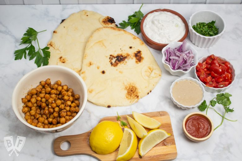 Overhead view of the ingredients for Falafel-Spiced Chickpea Flatbreads.