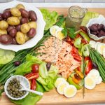 Overhead view of a King Salmon Niçoise Salad Board.