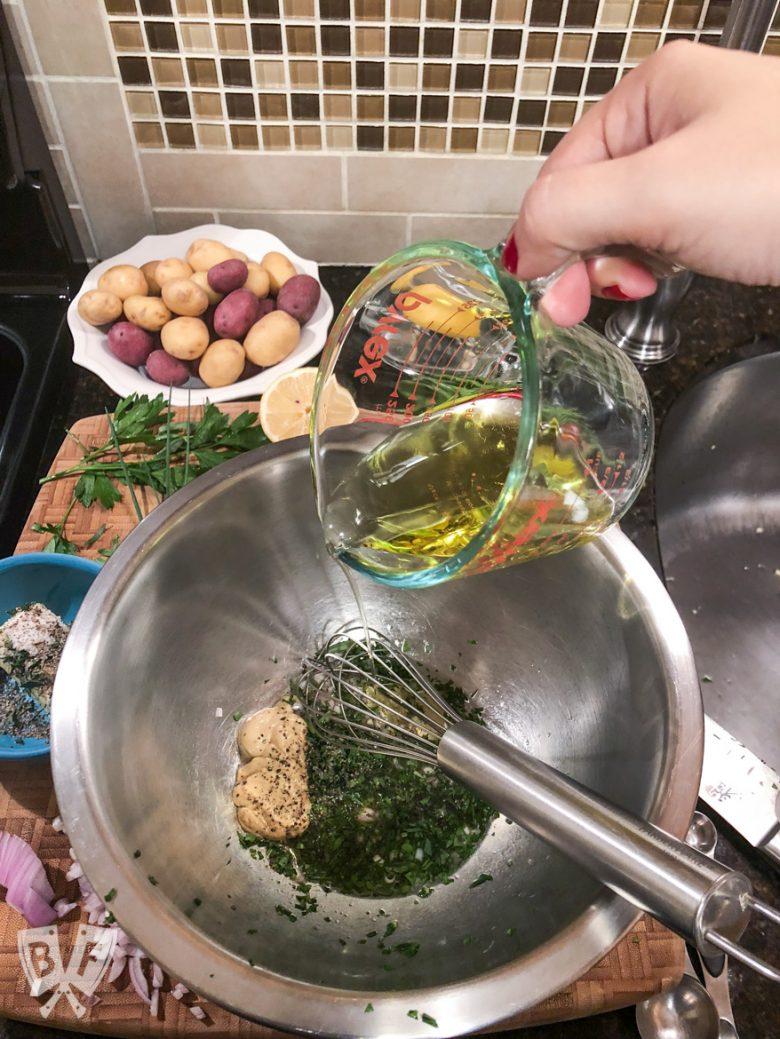 Overhead view of making vinaigrette for King Salmon Niçoise Salad Board.