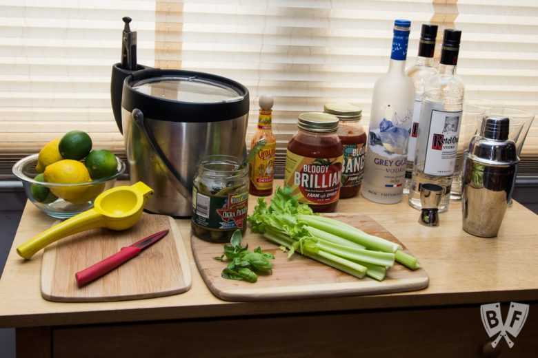 Front view of a bloody mary bar with garnishes.