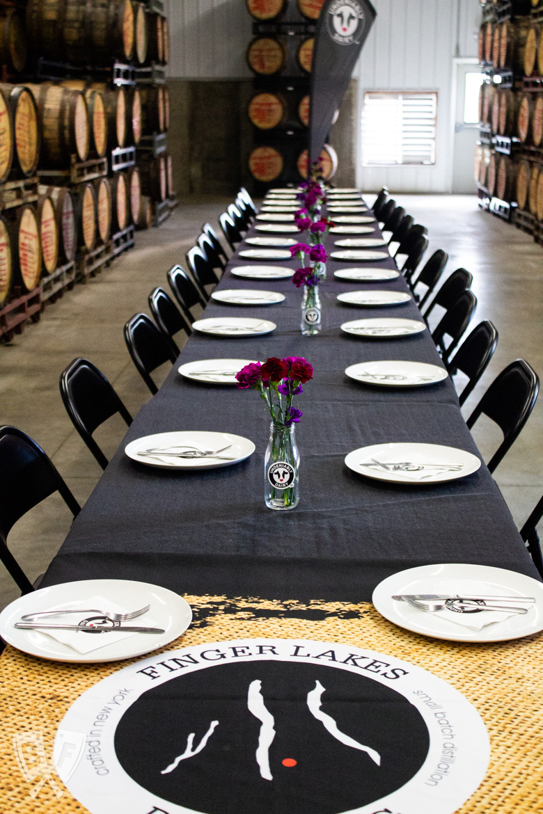 Table set for lunch in the barrel room of Finger Lakes Distilling