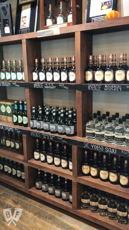 Shelves full of bottles of spirits at a distillery.