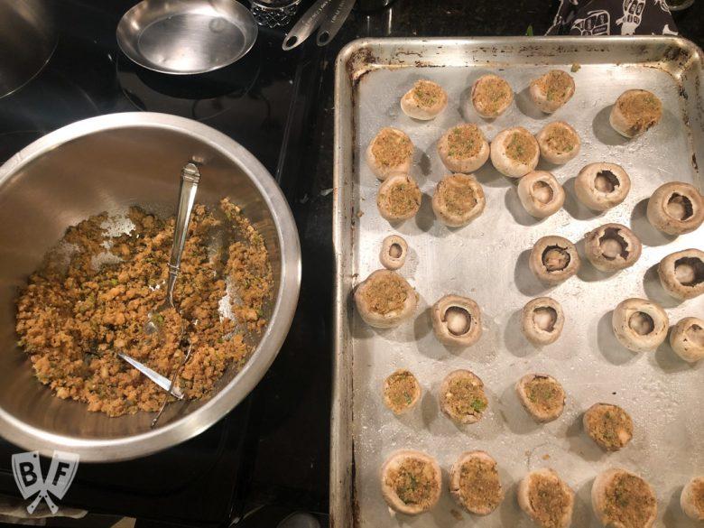 Stuffing mushroom caps full of an Italian bread crumb mixture.