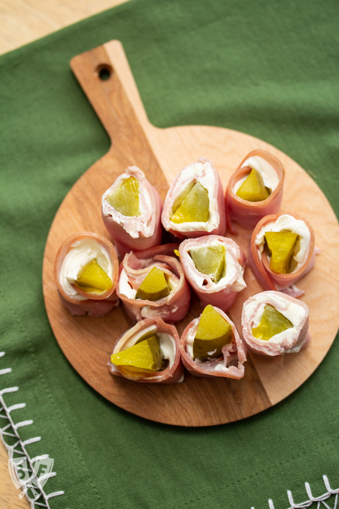 Small cutting board filled with sliced pickle treat appetizers.