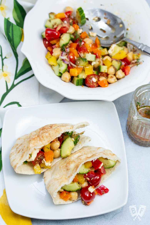 Mediterranean Chickpea Salad with Lemon-Herb Vinaigrette stuffed into pita bread