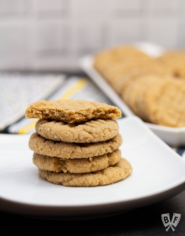 A stack of peanut butter cookies - the top one has been bitten