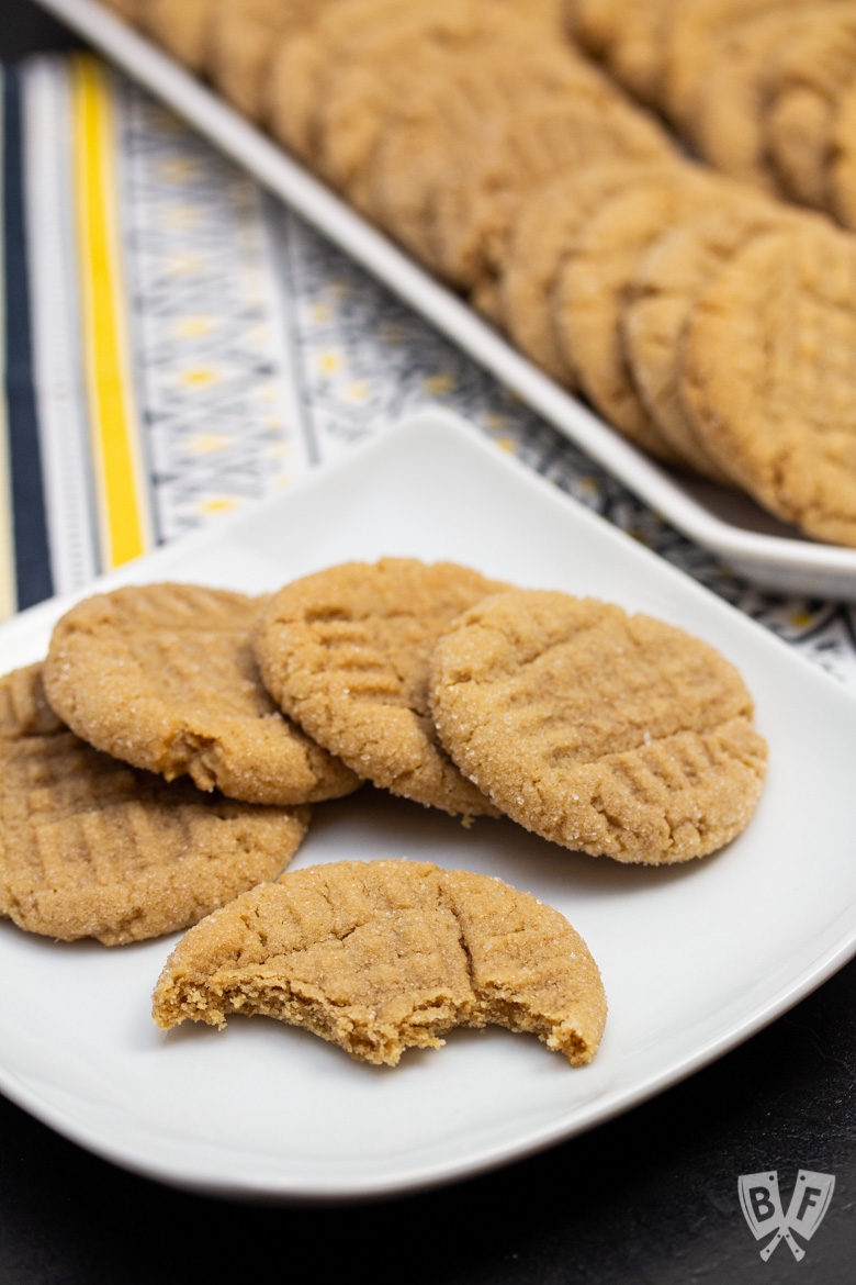 Plate of peanut butter cookies with bites taken out of one
