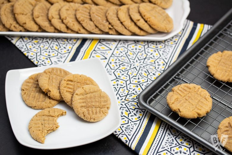 Peanut butter cookies on a platter, plate, and baking sheet