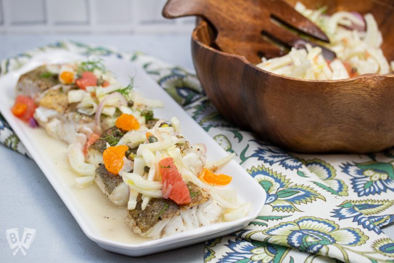 Cod topped with fresh fennel citrus salad.