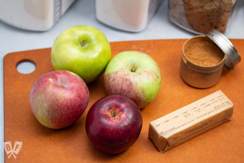 4 apples next to ingredients for baking apple pie