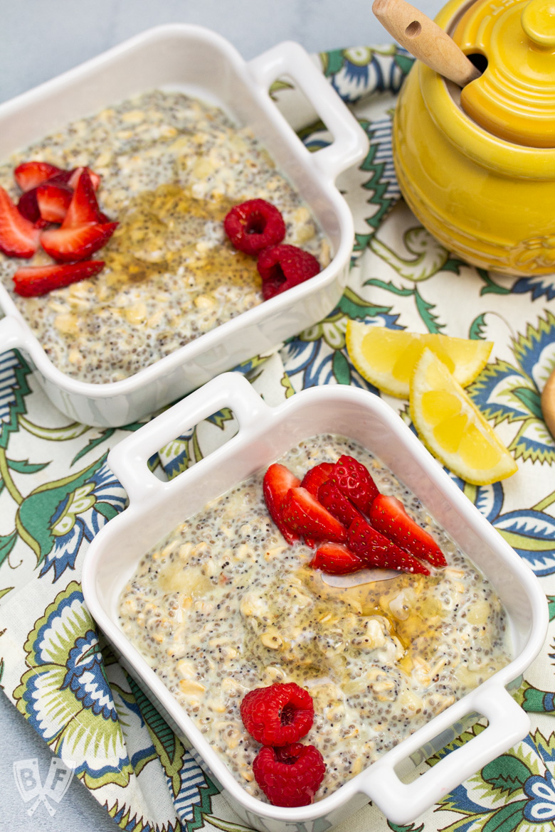 Bowls of Lemon Poppy Seed CBD Chia Pudding garnished with berries and honey