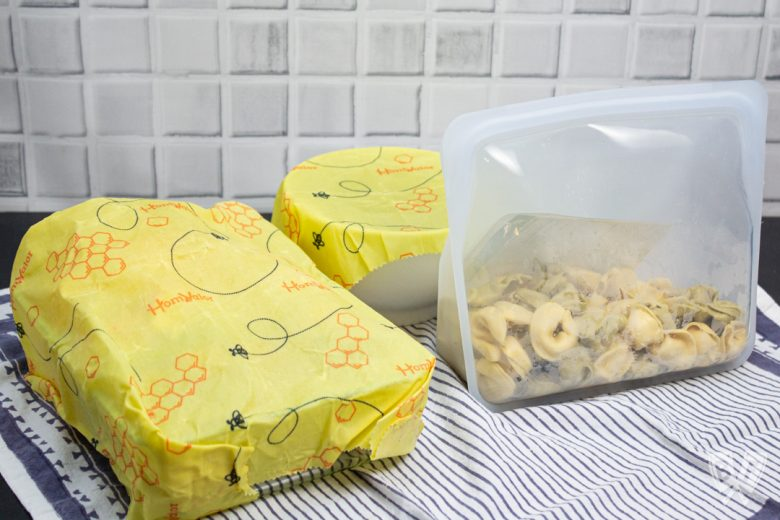 Beeswax wrap being used to cover dishes in an environmentally friendly manner
