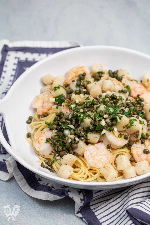 Bowl full of Shrimp + Scallop Linguine with Lemon Caper Butter