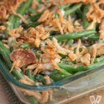 Casserole dish full of green bean casserole for Thanksgiving