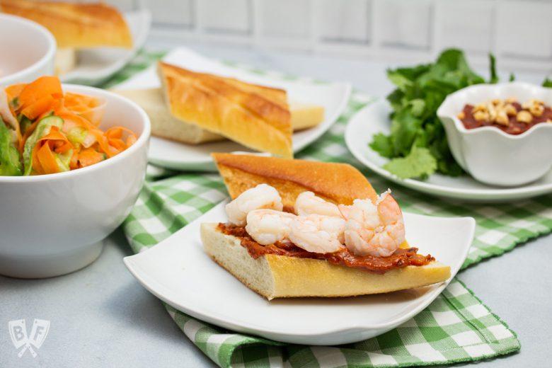 Assembling Vietnamese shrimp sandwiches with peanut sauce