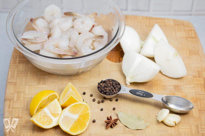 Ingredients for a Vietnamese shrimp boil on a butcher block
