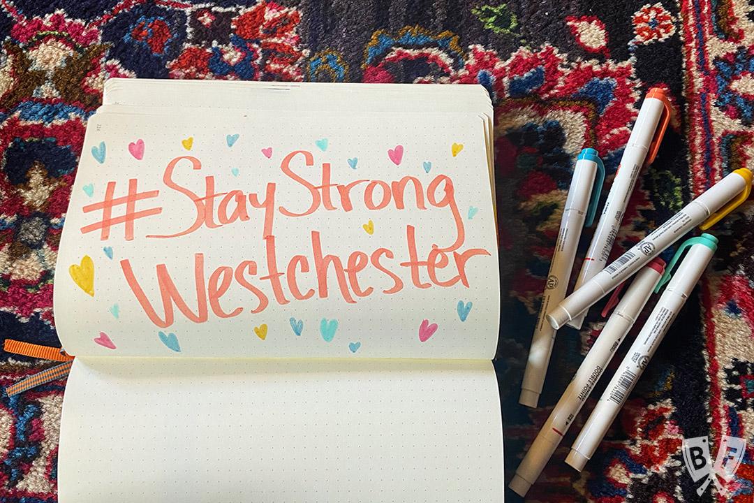 Notebook with #StayStrongWestchester written inside