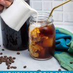 Pouring milk into a glass of cold brew coffee